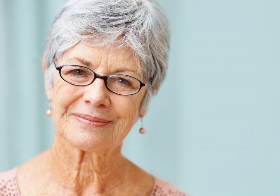 Closeup of a beautiful retired senior woman smiling