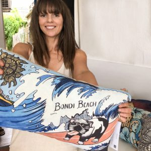 Streetart Society founder Leah Albert with cushion from Surfer Doggo collection by rachel giddens.