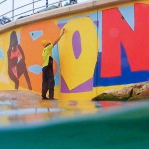 Luke Kennedy completes his vibrant Bondi mural during the 2020 lockdown.