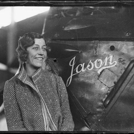 Amy next to  Jason her biplane, Australia