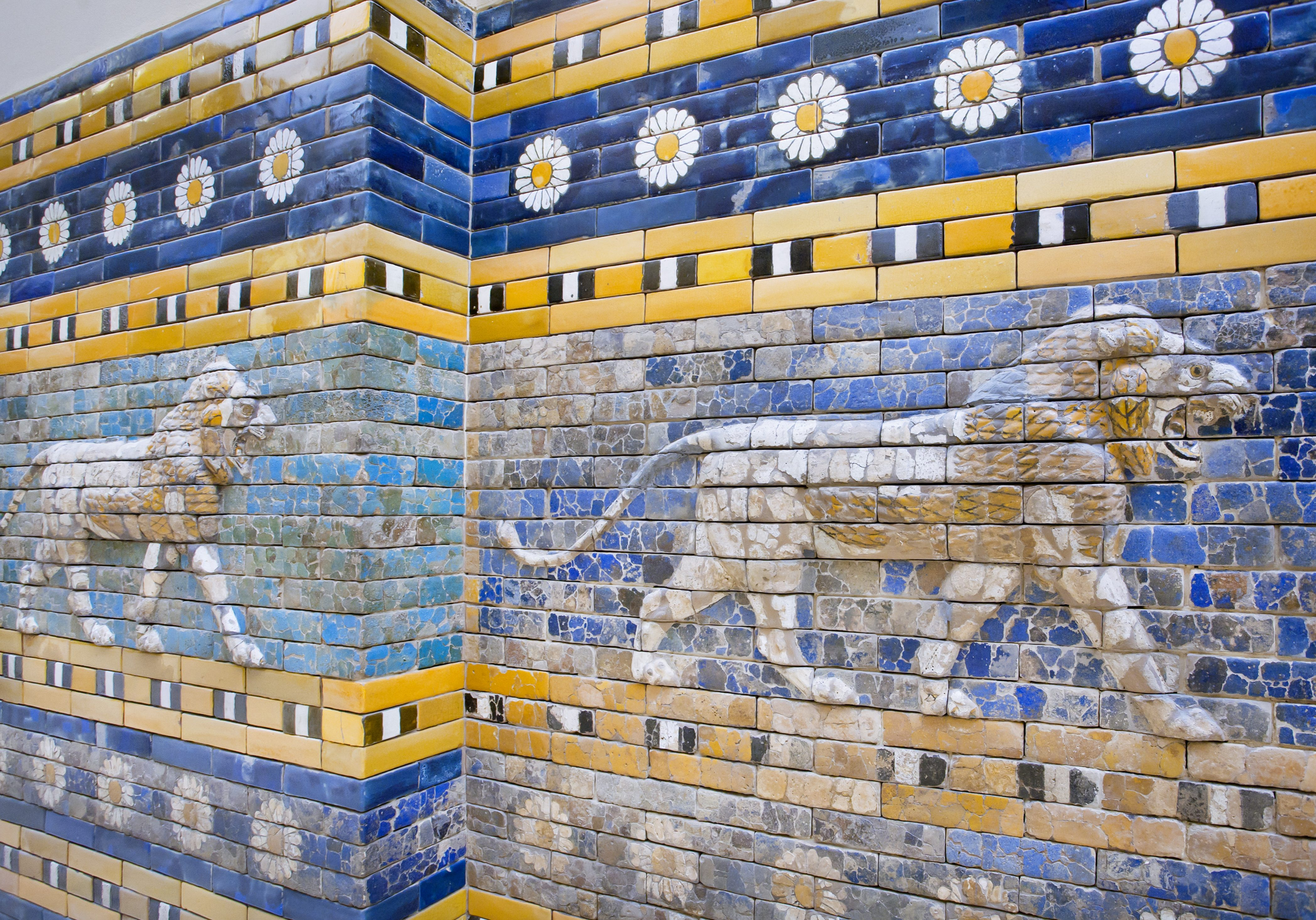 Lions following on the hunt, patterned wall of  the historical city of Babylon. Artifact saved by Pergamon Museum in Berlin.