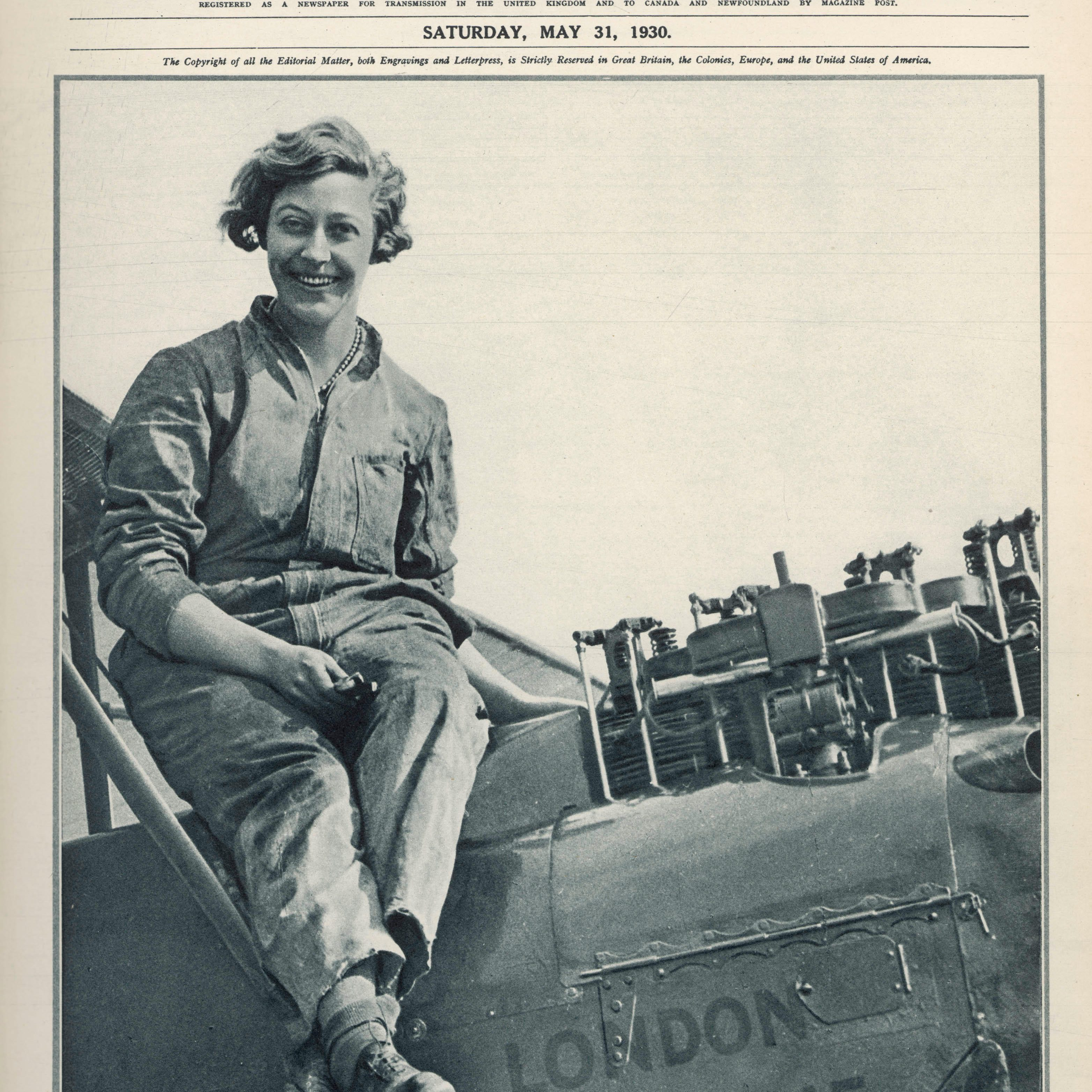 G3749P Miss Amy Johnson overhauling  her Gypsy Moth aeroplane after landing in Australia. She was the first woman pilot  to fly alone to Australia      Date: May 1930