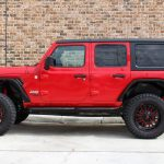 2018 jeep wrangler unlimited jl left side angle red