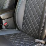 white 2019 jeep wrangler unlimited jl Custom pattern black leather front seats with white stitching up close