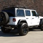 white 2019 jeep wrangler unlimited jl right rear angle