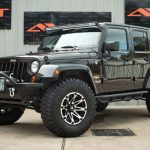 rugged brown 2013 jeep wrangler unlimited jk left front angle