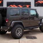rugged brown 2013 jeep wrangler unlimited jk right rear angle
