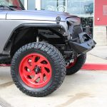 2016 Gray Wrapped JK Jeep 20x10 Fuel Vortex D637 wheels in custom candy red 35x13.50R20 Nitto Ridge Grappler tires