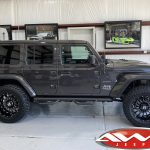 "2020 Gray JL Jeep 2.5"" Rough Country Lift 20"" Ballistic Off-road Machete Wheels Gloss Black 35x12.50R20 tires side angle"