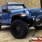 "2019 JL Jeep 2.5"" lift 20x10 Ballistic Tank wheels 35"" tires DV8 bumper 50"" light bar right front angle"