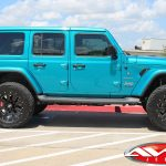 "2019 Bikini Teal Sport JL Jeep 2.5″ Mopar Jeep lift 20×10 Moto Metal MO 962 wheels gloss black with milled accents 35"" tires"