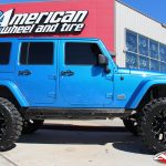 "Blue JK Jeep 4"" Rough Country lift fox remote reservoir shocks 22x12 fuel offroad assault wheel 37"" nitto mud grappler tires"