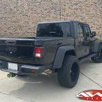 "2020 Black Jeep Gladiator 2.5″ Rough Country lift 22×12 Hostile H114 ""Fury"" wheels asphalt 35″ tires left rear angle"