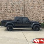 "2020 Black Jeep Gladiator 2.5″ Rough Country lift 22×12 Hostile H114 ""Fury"" wheels asphalt 35″ tires side view"