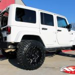"2017 white jk sport 3.5"" rough country lift 20x12 fuel d574 cleaver wheels 35"" toyo tires rough country steps DV8 rear bumper"