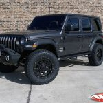 """2020 Jeep JL wrangler 2.5"""" Lift DV8 Front bumper with winch 20x9 XD """"FMJ"""" 35"""" A/T tire Nfab side steps left front angle"""