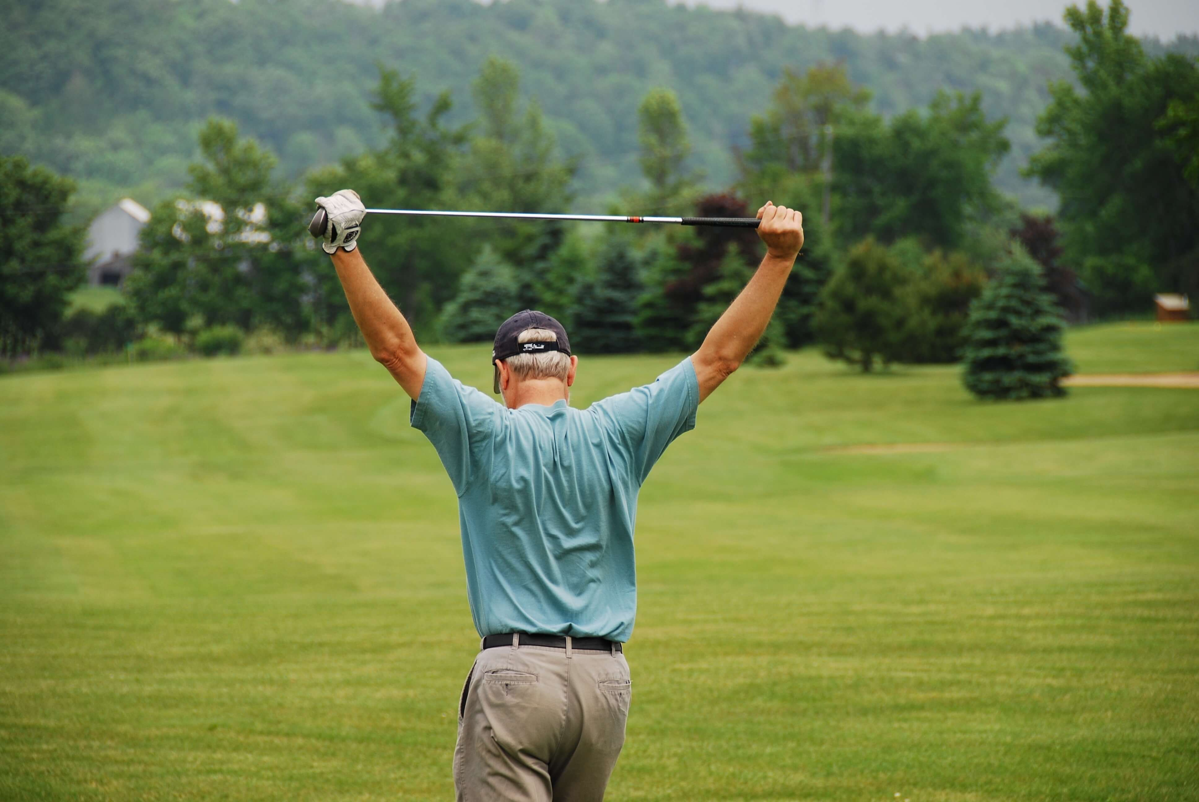 confident golfer stretching out
