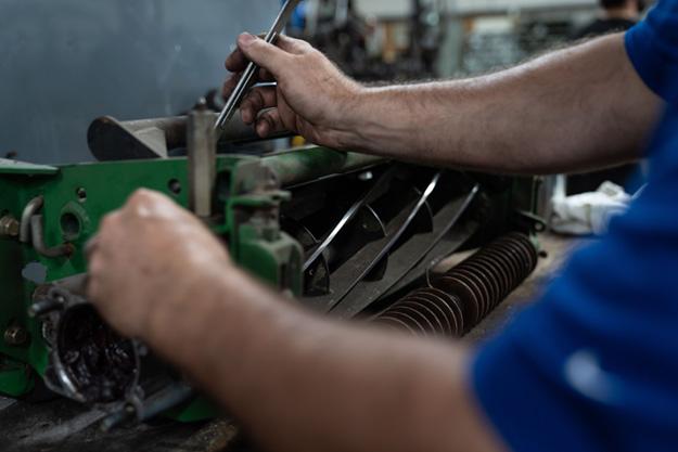 working on mower blades