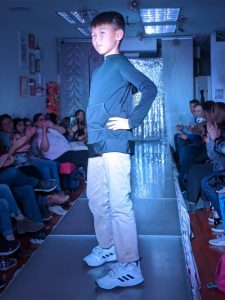 boy in fashion show
