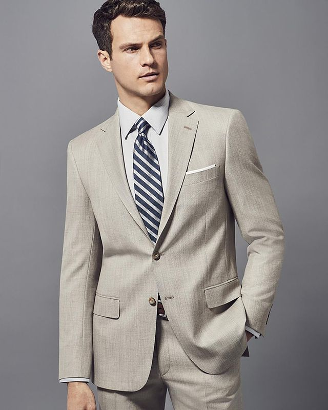 Image of Hart Schaffner Marx model in a beige suit