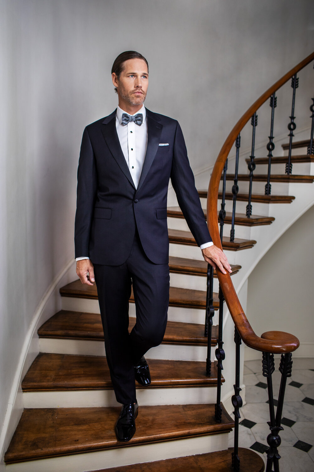 Man Stand on stairs in tuxedo