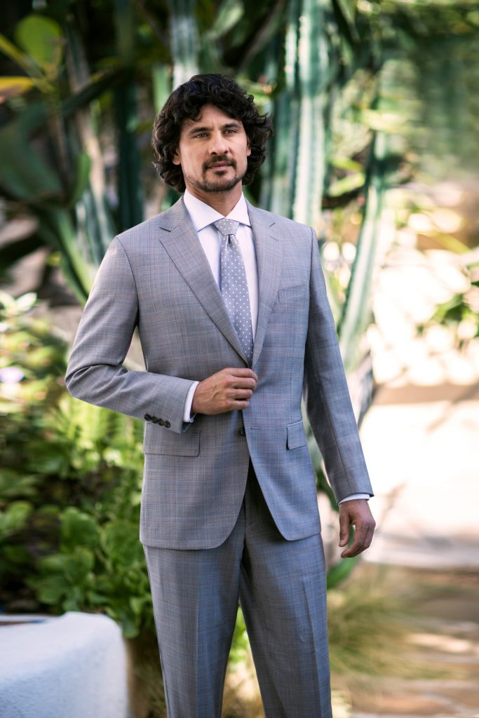 Man standing in plaid suit